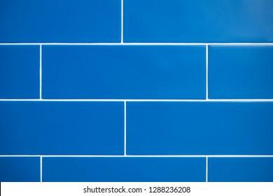Blue bathroom tiles, close up, front view