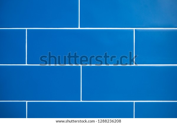 Blue bathroom tiles, close up, front view