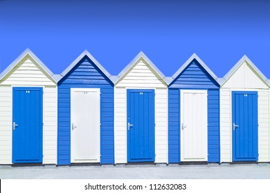 blue beach hut under blue sky