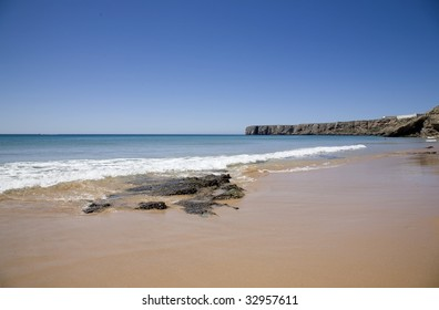 The blue beaches of southern Portugal, the Algarve. Martinhal beach in a summer morning