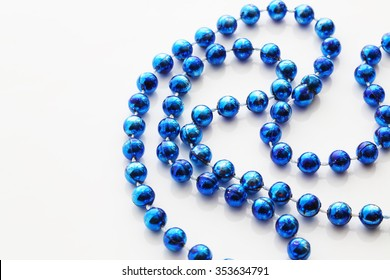 blue bead isolated on white with shadow