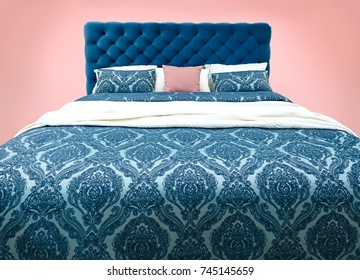 Blue bed furniture with patterned bed linen . Soft velour fabric bed. Classic modern furniture on isolated background