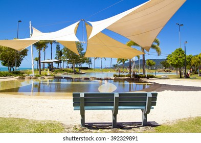 blue bench near water ,ocean , airlie beach Island, sand, view , australian   holiday ,vacation, pool, water,  sunny day, shadow ,white , cover photo