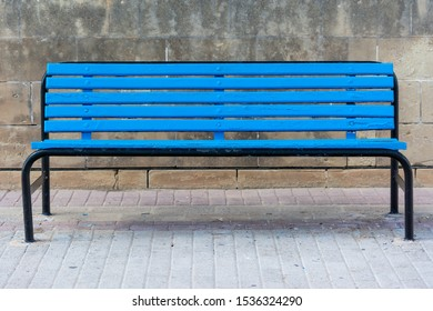 Blue bench on sunny day