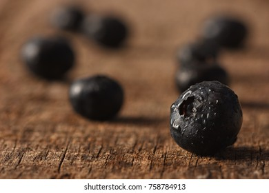 Blue berries on a wooden table