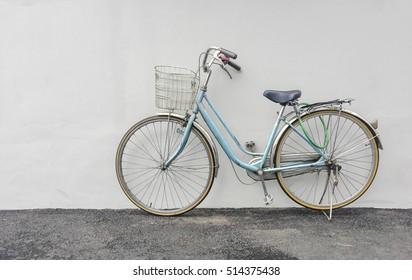 blue bicycle on leaf Wall background, vintage style