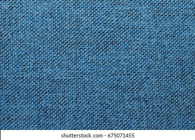 Blue and black fabric texture or background, wool, tweed, melange cloth, closeup