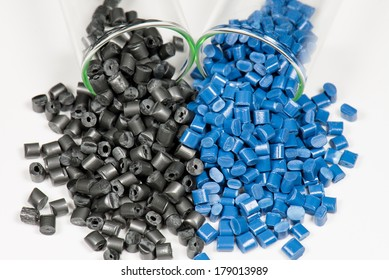 blue and black polymer pellets in test tubes in laboratory