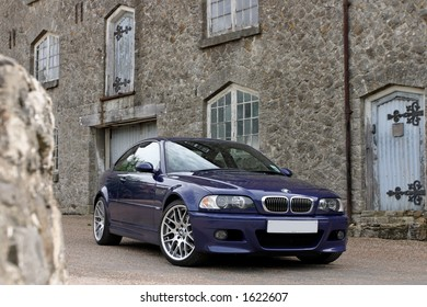 Blue BMW M3 CS front with mansion, Kent