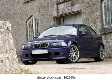 Blue BMW M3 CS with mansion Kent