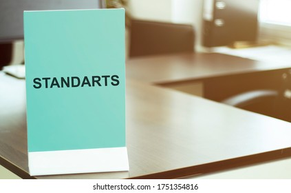 blue board with text STANDARTS on the office background
