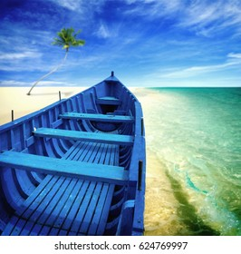 Blue boat and palm tree on the beach