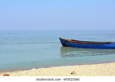 Blue boat in the sea at the shore