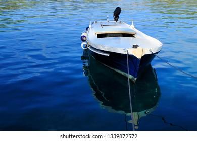 blue boat in a blue sea, Valdarke, island Losinj, Croatia