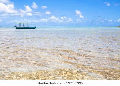 Blue Boat in a Tropical Beach in Brazil, Carneiros Beach, Pernambuco
