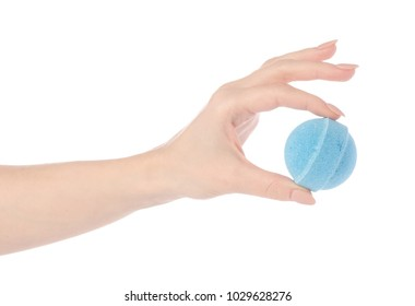 Blue  bomb for bath in hand on white background isolation