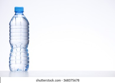 blue bottle of water on white background