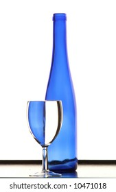 Blue bottle with blue wineglass on the table