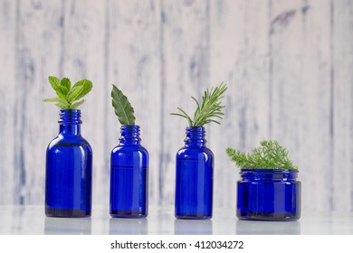 Blue bottles of aromatic essential