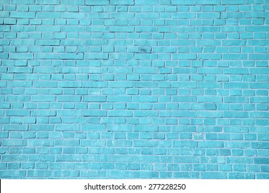 Blue brick wall background.