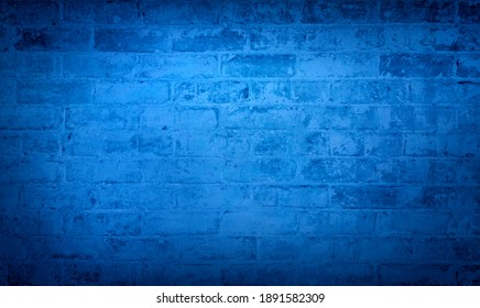 Blue brick wall background. Monotone texture of a flat brick wall close-up.