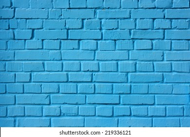 A blue brick wall. The brick wall painted in blue.