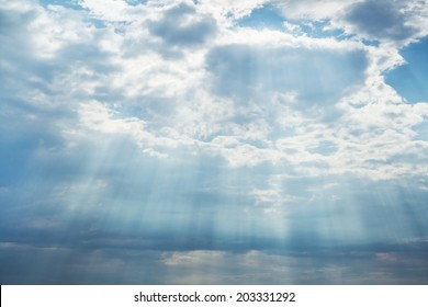 Blue bright sky background with clouds and emotional mood for dreams, mourning, death concepts.