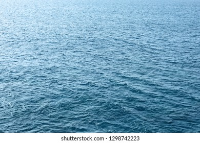 Blue and bright water surface of the Atlantic ocean.
