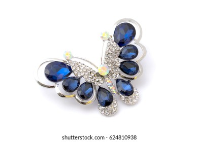 Blue brooch isolated on white background