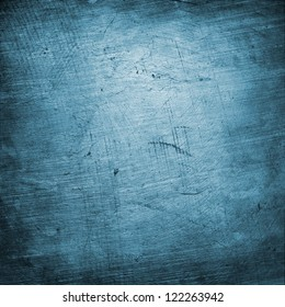 blue brushed , scratched , spotted texture  ; abstract grunge background