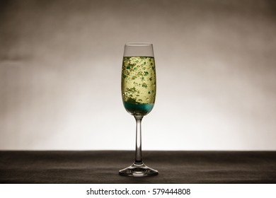 Blue bubbles in tall champagne glass