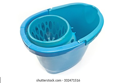 Blue bucket with mop squeezing isolated on white