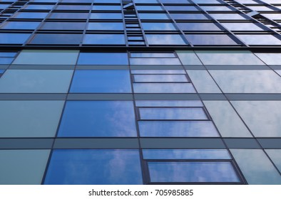 blue building glass mirror modern tower office facade skyscraper perspective