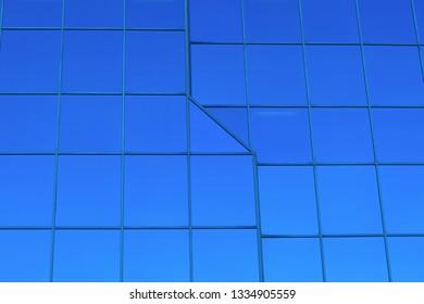 blue building glass windows office finance perspective skyscraper
