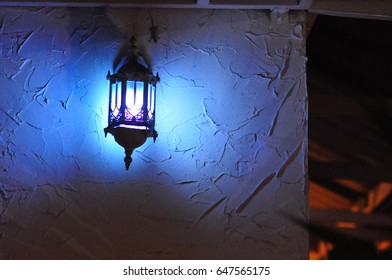 Blue bulb lamp on wall in room look vintage light