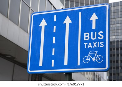Blue Bus, Taxi and Bicycle Traffic Sign in Urban Setting