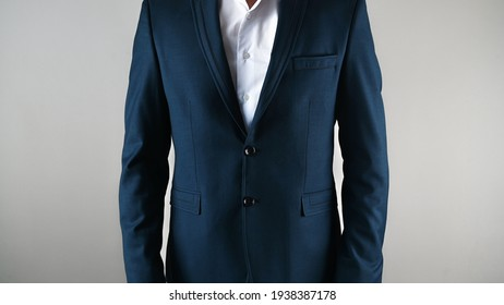 Blue business suit, with a white shirt, on an isolated background . High quality photo