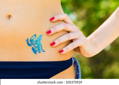 Blue butterfly glitter-tattoo