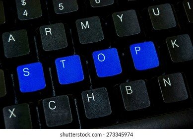 blue button stop word on black computer keyboard