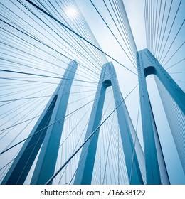 blue cable-stayed bridge closeup, upward view