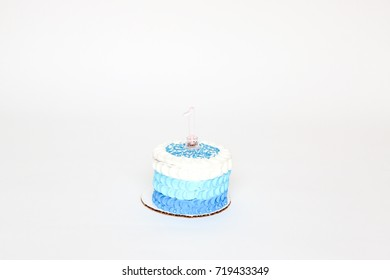 a blue cake for a baby birthday boy