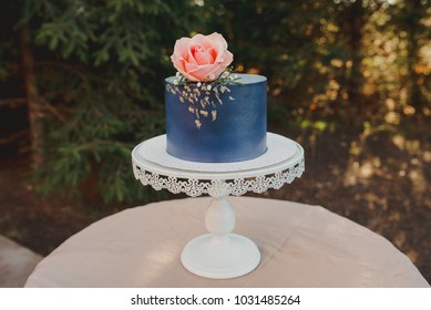 Blue cake with rose on top