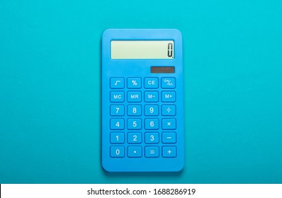 Blue calculator on blue background. Calculation or counting. Minimalism. Top view