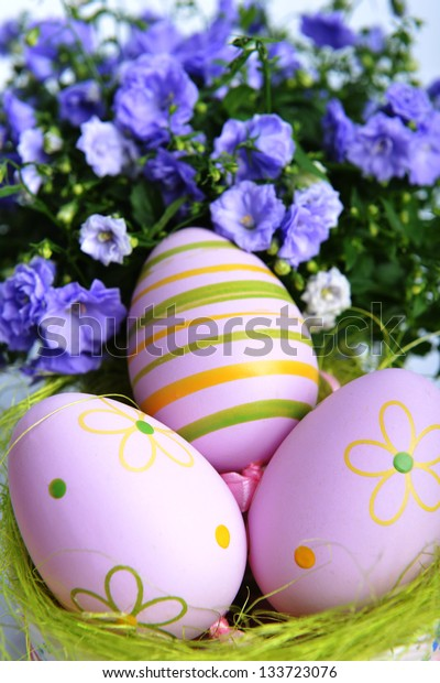 blue campanula flowers  and easter eggs