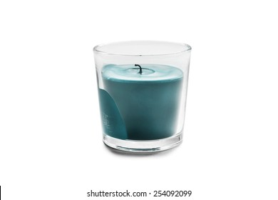Blue candle in glass candlestick isolated over white