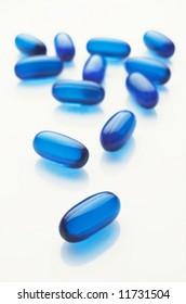 Blue capsules  on white background