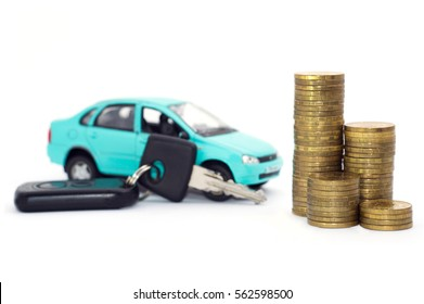A blue car with black keys and coins stack isolated on white background