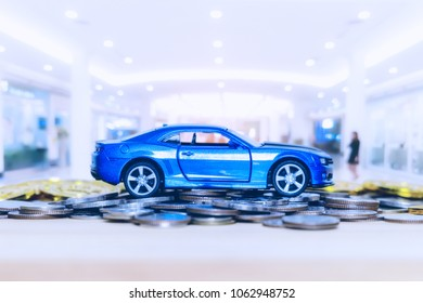 Blue car a lot of coins