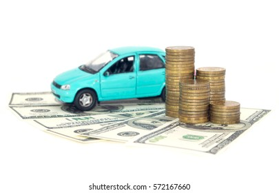 A blue car with coins money and dollars isolated on white background.