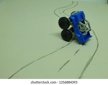 blue car crash on the street closeup isolated